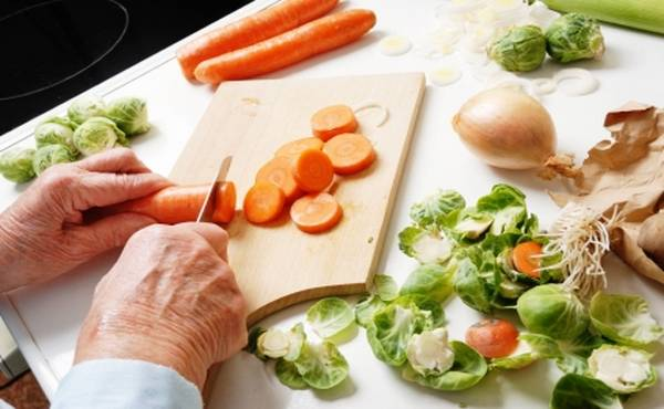 hands of a senior woman preparing vegetables for cooking, part of a series